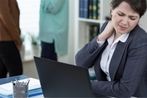 businesswoman with tension in neck from bad posture