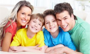 a family with good dental health through the help of dentistry
