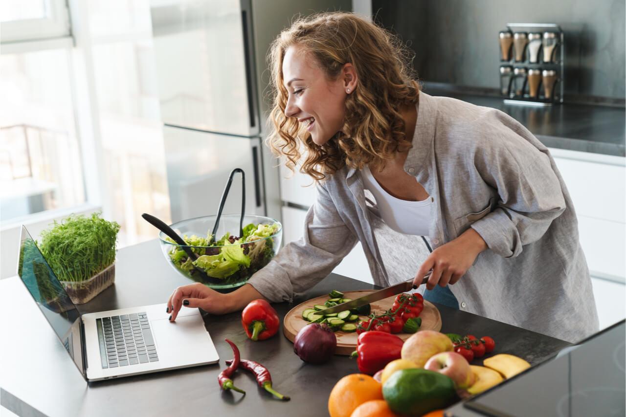 The woman is preparing her healthy snacks.