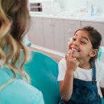 little girl with shark teeth