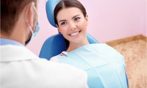 The woman visits her dentist to get dental contouring.